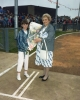 1987 Councillor D. Warsop, Lady Mayor of Ipswich, receives a bouquet of flowers from one of the Ipswich Girls.